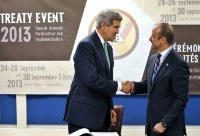 Date: 09/25/2013 Description: U.S. Secretary of State John Kerry, left, shakes hands with Under Secretary-General for Legal Affairs Miguel Serpa Soares after signing the Arms Trade Treaty during the 68th session of the United Nations General Assembly at UN headquarters. (AP Photo/Jason DeCrow) © AP Image