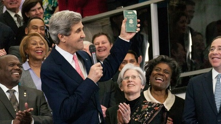 Date: 02/04/2013 Description: Secretary of State John Kerry displays his first diplomatic passport, while delivering welcome remarks to U.S. Department of State employees in Washington, D.C., February 4, 2013.  - State Dept Image