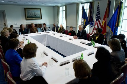 Defense Secretary Chuck Hagel talks with members of the Defense Advisory Committee on Women in the Services during a meeting at the Pentagon, Sept. 27, 2013.