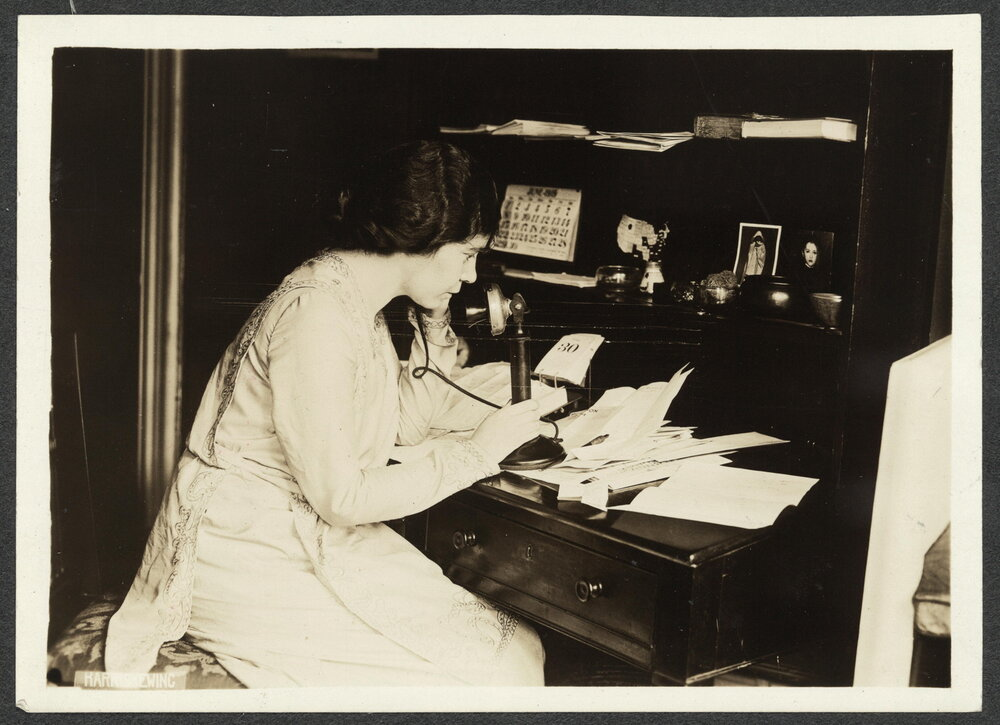 Alice Paul seated at a desk on the telephone   (     Library of Congress     )