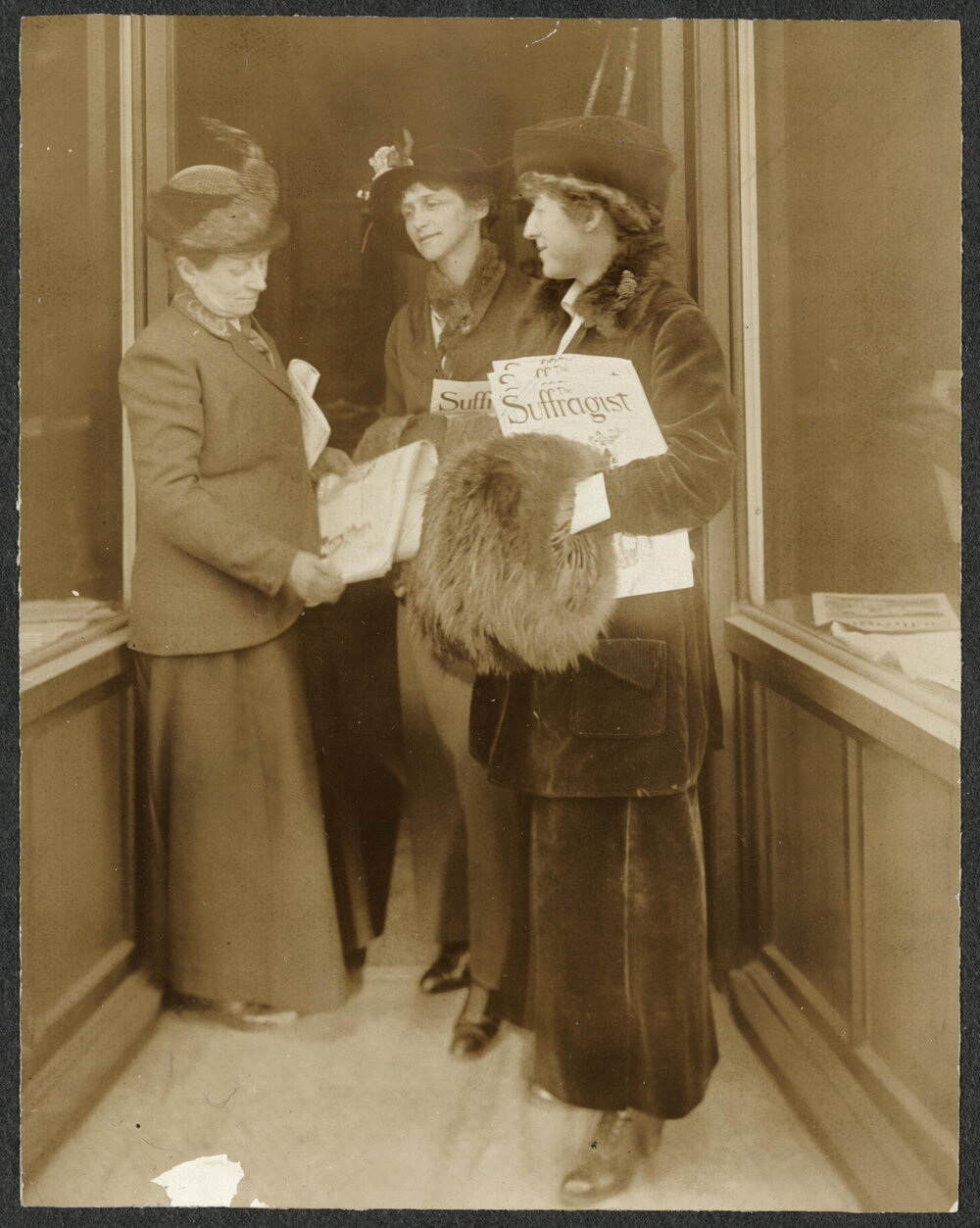 Rep. Jeanette Rankin of Montana (right) holding The Suffragist   newspaper  (    Library of Congress    )